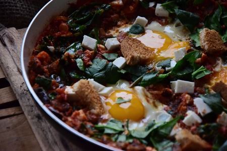 Shakshuka with eggplant, paprika and feta cheese